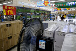 Chinese brand home appliances sit on display for sale at a hypermarket in Beijing, Wednesday, July 11, 2018. China's government has criticized the latest U.S. threat of a tariff hike as
