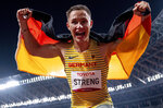 In this photo provided by Olympic Information Services, Felix Streng of Germany celebrates after competing in the men's 100m T64 final during the Tokyo 2020 Paralympics Games at the National Stadium in Tokyo, Japan, Monday, Aug. 30, 2021. (Bob Martin/OIS via AP)