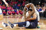 Villanova guard Justin Moore, bottom, tries to keep the ball from DePaul guard Markese Jacobs during the first half of an NCAA college basketball game Wednesday, Feb. 19, 2020, in Chicago. (AP Photo/Jeff Haynes)