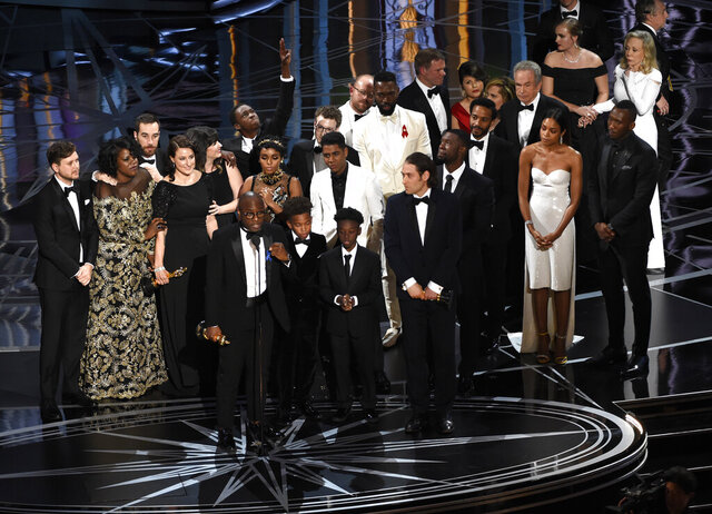 FILE - This Feb. 26, 2017 file photo shows Barry Jenkins and the cast and crew of