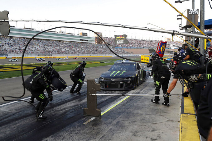 NASCAR Cup Series driver Kurt Busch (1) comes in for a pit stop during a NASCAR Cup Series auto race at the Las Vegas Motor Speedway Sunday, Sept. 26, 2021, in Las Vegas. (AP Photo/Steve Marcus)