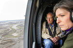 Sen. Chuck Grassley, R-Iowa, and Sen. Joni Ernst, R-Iowa, survey the flooded areas around the Missouri River in Iowa from a helicopter, Friday, April 12, 2019. They were joining a tour of Vice President Mike Pence, who was to meet with some of those affected by the recent severe flooding in the Iowa and Nebraska region. (AP Photo/Nati Harnik)