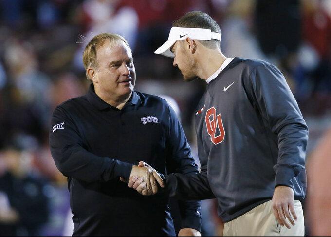 FILE - In this Nov. 11, 2017, file photo, TCU head coach Gary Patterson, left, and Oklahoma head coach Lincoln Riley shake hands before their NCAA college football game in Norman, Okla. Oklahoma plays at TCU on Saturday, Oct. 20, 2018.  (AP Photo/Sue Ogrocki, File)