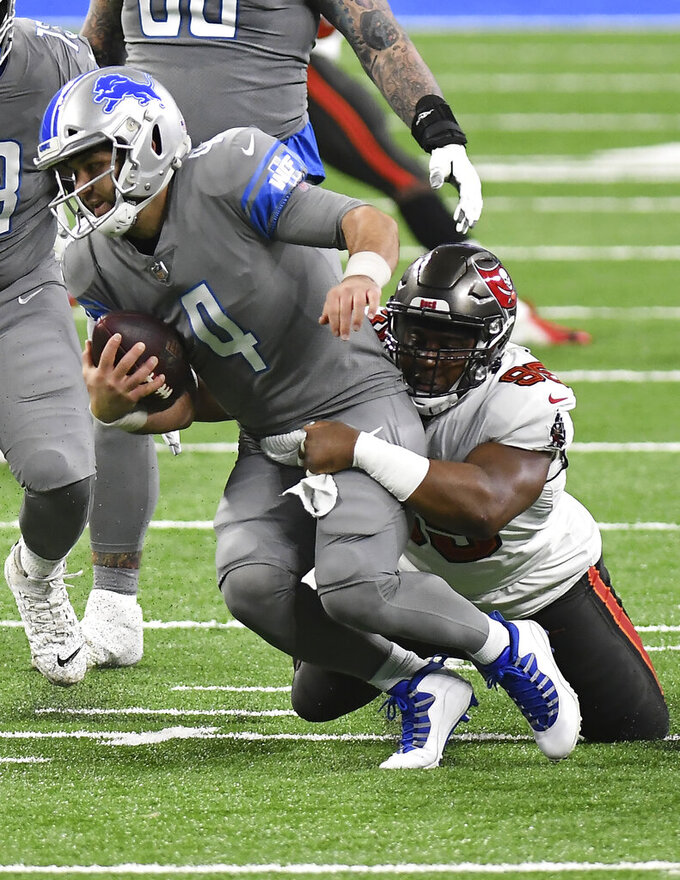 Detroit Lions quarterback Chase Daniel (4) is sacked by Tampa Bay Buccaneers' Jaydon Mickens (85)during the first half of an NFL football game, Saturday, Dec. 26, 2020, in Detroit. (AP Photo/Lon Horwedel)
