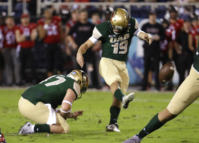 UAB place kicker Nick Vogel (19) kicks a field goal during the first half of the Boca Raton Bowl NCAA college football game against Northern Illinois, Tuesday, Dec. 18, 2018, in Boca Raton, Fla. (AP Photo/Lynne Sladky)
