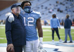 Senior Tomon Fox embraces North Carolina coach Mack Brown as 16 Tar Heel seniors are recognized before playing their final home game in Kenan Stadium on Saturday, December 5, 2020 in Chapel Hill, N.C.(Robert Willets/The News & Observer via AP)