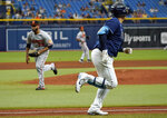 Tampa Bay Rays' Ji-Man Choi watches his two-run single off Baltimore Orioles relief pitcher Marcos Diplan, left, during the fourth inning of a baseball game Thursday, Aug. 19, 2021, in St. Petersburg, Fla. (AP Photo/Chris O'Meara)