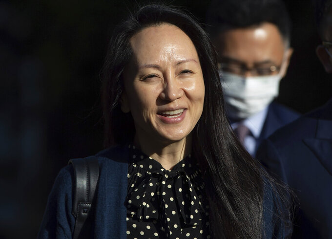 FILE - In this Sept. 24, 2021, file photo, Meng Wanzhou, chief financial officer of Huawei, smiles as she leaves her home in Vancouver. A pair of American siblings, Cynthia and Victor Liu, have returned to the U.S. on Sunday, Sept. 26, 2021, after China lifted an exit ban following Canada's release of Meng wanted in the U.S. on fraud charges. (Darryl Dyck/The Canadian Press via AP, File)