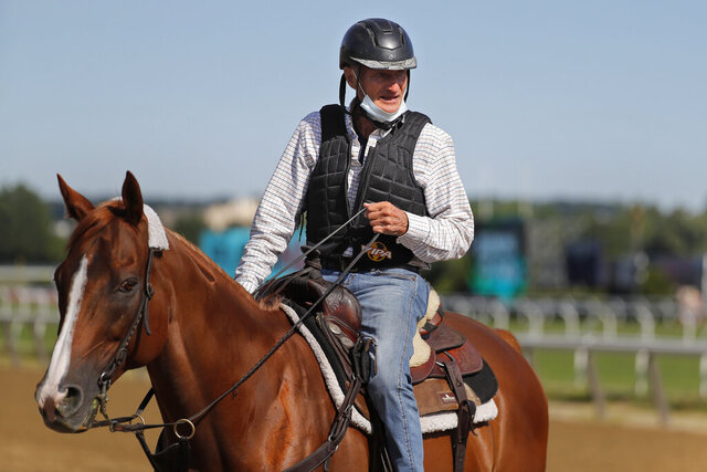Tiz The Law trainer Barclay Tagg rides a horse on the main track during workouts at Belmont Park in Elmont, N.Y., Wednesday, June 17, 2020. Tiz the Law is the favorite in the 152nd running of the Belmont Stakes scheduled to be run on Saturday. (AP Photo/Seth Wenig)