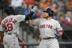 Boston Red Sox's Christian Vazquez, right, celebrates his home run with Jackie Bradley Jr. (19) during the fourth inning of a baseball game against the Baltimore Orioles, Friday, June 14, 2019, in Baltimore. (AP Photo/Nick Wass)