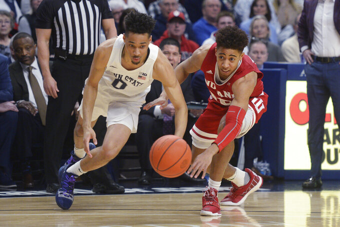 Penn State's Myreon Jones (0) and Indiana's Rob Phinisee (10) go after a loose ball during the first half of an NCAA college basketball game Wednesday, Jan. 29, 2020, in State College, Pa. (AP Photo/Gary M. Baranec)