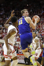 South Dakota State's Noah Freidel (11) shoots against dIndiana's Al Durham (1) during the second half of an NCAA college basketball game, Saturday, Nov. 30, 2019, in Bloomington, Ind. (AP Photo/Darron Cummings)