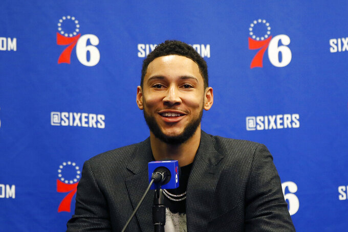 """FILE - In this March 11, 2020, file photo, Philadelphia 76ers' Ben Simmons smiles while speaking at a news conference before an NBA basketball game against the Detroit Pistons in Philadelphia. Philadelphia 76ers All-Star guard Ben Simmons is closer to getting cleared to play, should the NBA season resume. Simmons, the league leader in steals, was sidelined with nerve issues in his lower back when the season suspended was March 11 because of the coronavirus pandemic. """"We've took our time, we've been methodical and thoughtful about his recovery and rehab, just to make sure, because we weren't in a rush,"""" 76ers GM Elton Brand said on Tuesday, May 5, 2020. (AP Photo/Matt Slocum, File)"""