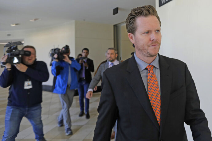 FILE - In this Nov. 15, 2019, file photo, Paul Petersen, an Arizona elected official accused of running a multi-state adoption scheme, leaves court following an initial appearance on charges filed in the state in Salt Lake City. (AP Photo/Rick Bowmer, File)