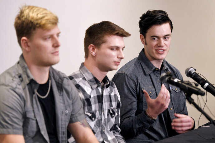 Carverton band members, from left, Michael Wiebel, Michael Curry and Christian Ferguson, talk about fellow member Kyle Yorlets during a press conference about the killing of fellow member Kyle Yorlets at Belmont University in Nashville on Monday, Feb. 11, 2019. Yorlets, the frontman for the rock band Carverton was gunned down during a robbery Thursday, Feb. 7. Police have charged five juveniles in the case. A memorial service was scheduled to follow.  (Shelley Mays/The Tennessean via AP)