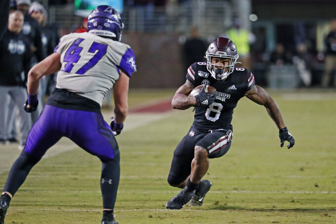 Mississippi State running back Kylin Hill (8) attempts to fake out Abilene Christian linebacker Jack Gibbens (47) during the second half of an NCAA college football game, Saturday, Nov. 23, 2019, in Starkville, Miss. Mississippi State won 45-7. (AP Photo/Rogelio V. Solis)