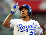 Kansas City Royals' Adalberto Mondesi gestures after his RBI single during the first inning of a baseball game against the Texas Rangers at Kauffman Stadium in Kansas City, Mo., Wednesday, May 15, 2019. (AP Photo/Orlin Wagner)