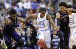 Washington's Jaylen Nowell, left to right, North Carolina's Kenny Williams and Washington's Matisse Thybulle battle for a loose ball in the first half during a second round men's college basketball game in the NCAA Tournament in Columbus, Ohio, Sunday, March 24, 2019. (AP Photo/Tony Dejak)