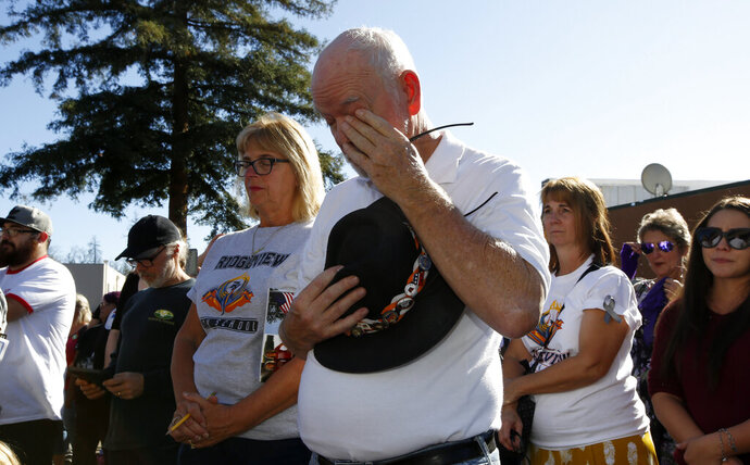 Mike Greer wipes his eyes during the 85 seconds of silence honoring the 85 people who died in last year's Camp Fire during ceremonies in Paradise, Calif., Friday, Nov. 8, 2019. Friday marks the one year anniversary of the wildfire that nearly destroyed the entire town of Paradise. (AP Photo/Rich Pedroncelli)
