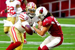 San Francisco 49ers middle linebacker Fred Warner breaks up a pass intended for Arizona Cardinals tight end Dan Arnold (85) during the first half of an NFL football game, Saturday, Dec. 26, 2020, in Glendale, Ariz. (AP Photo/Rick Scuteri)