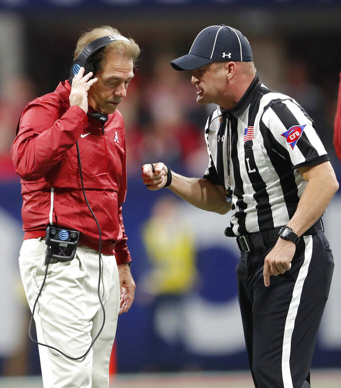 Alabama head coach Nick Saban speaks with an official during the first half of the Southeastern Conference championship NCAA college football game against Georgia, Saturday, Dec. 1, 2018, in Atlanta. (AP Photo/John Bazemore)