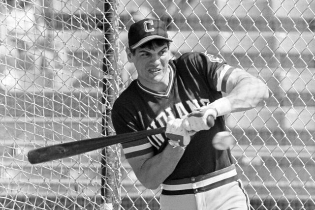 """FILE - In this March 5, 1982, file photo, Cleveland Indians left fielder Joe Charboneau gets jammed in the batting cage at Cleveland's spring training camp in Tucson, Ariz. The charismatic Charboneau arrived on the scene as that promising prospect who was the life of the party. His tales were epic off the field — opened beer bottles with his forearm or his eye socket (just once or twice, he cautioned). Once fixed a broken nose with pliers. Stitched up a cut with fishing line. Charboneau sees a little bit of himself in the iconic baseball film """"The Natural,"""" that finished tied for No. 8 in The Associated Press Top 25 favorite sports movies poll. (AP Photo/Sal Veder, Fle)"""