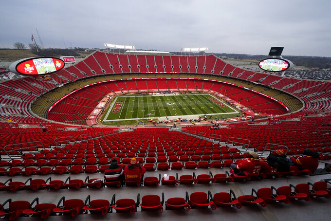 Players warm up on the field in Arrowhead Stadium before the AFC championship NFL football game between the Kansas City Chiefs and the Buffalo Bills, Sunday, Jan. 24, 2021, in Kansas City, Mo. (AP Photo/Charlie Riedel)