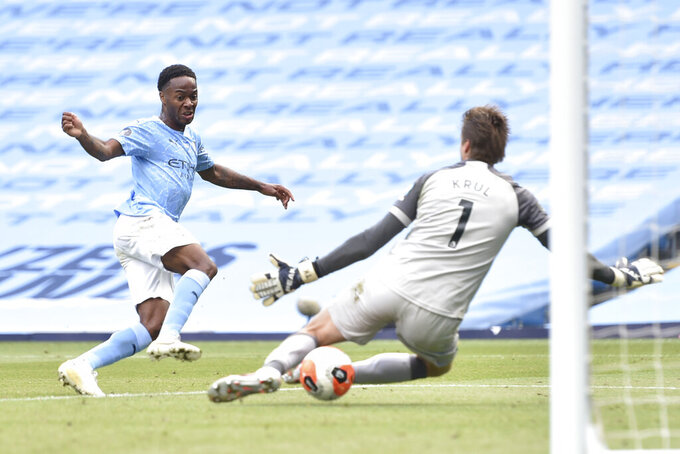 Manchester City's Raheem Sterling scores his side's third goal during the English Premier League soccer match between Manchester City and Norwich City at the Etihad Stadium in Manchester, England, Sunday, July 26, 2020. (Peter Powelll/Pool via AP)