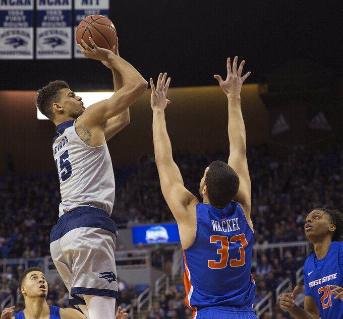 Nevada forward Trey Porter (15) shoots over Boise State forward David Wacker (33) in the first half of an NCAA college basketball game in Reno, Nev., Saturday, Feb. 2, 2019. (AP Photo/Tom R. Smedes)