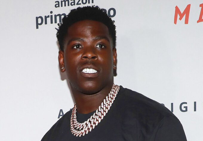 """FILE - In this Aug. 1, 2019 file photo, Casanova attends the world premiere of Amazon Prime Video's """"Free Meek"""" limited documentary series at the Ziegfeld Ballroom in New York. Authorities said Tuesday, Dec. 1, 2020, that Casanova, whose legal name is Caswell Senior, was among 18 people indicted in connection to a litany of gang-related crimes including racketeering, murder, drugs, firearms and fraud offenses. (Photo by Jason Mendez/Invision/AP, File)"""