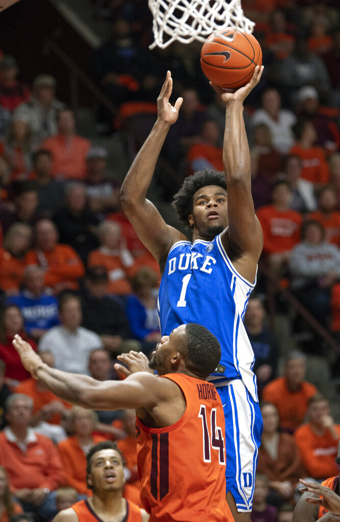Duke center Vernon Carey Jr. (1) shoots over Virginia Tech forward P.J. Horne (14) during the first half of an NCAA college basketball game Friday, Dec. 6, 2019, in Blacksburg, Va. (AP Photo/Don Petersen)