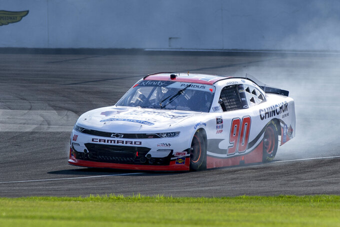 Preston Pardus (90) during practice for the NASCAR Xfinity Series auto race at Indianapolis Motor Speedway, Friday, Aug. 13, 2021, in Indianapolis. (AP Photo/Doug McSchooler)