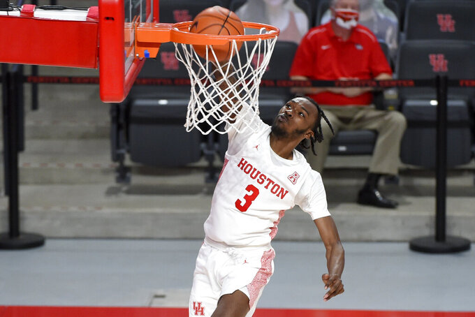 Houston guard DeJon Jarreau dunks during the second half of an NCAA college basketball game against Lamar, Wednesday, Nov. 25, 2020, in Houston. (AP Photo/Eric Christian Smith)