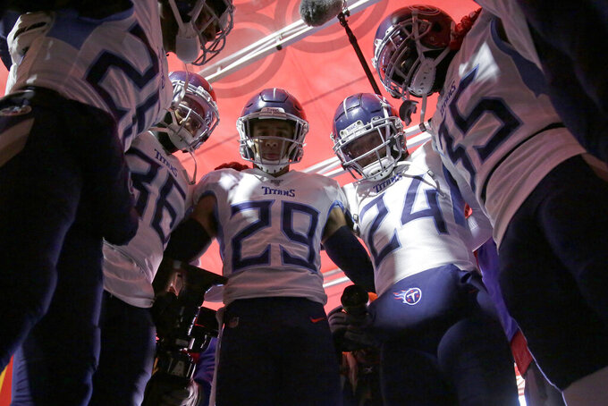Tennessee Titans players huddle in the tunnel before the NFL AFC Championship football game against the Kansas City Chiefs Sunday, Jan. 19, 2020, in Kansas City, MO. (AP Photo/Jeff Roberson)