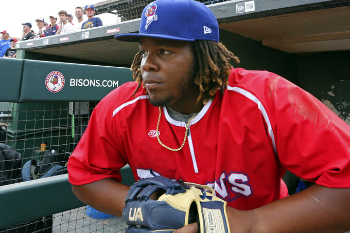 FILE - In this July 31, 2018, file photo, Toronto Blue Jays top prospect third baseman Vladimir Guerrero Jr. looks on before a minor league baseball with the Buffalo Bisons against the Lehigh Valley IronPigs in Buffalo, N.Y. The displaced Toronto Blue Jays will play in Buffalo, New York, this year amid the pandemic. An official familiar with the matter told The Associated Press on Friday that the Blue Jays will play at Sahlen Field. The official spoke on condition of anonymity as they were not authorized to speak publicly ahead of an announcement. (AP Photo/Jeffrey T. Barnes, File)