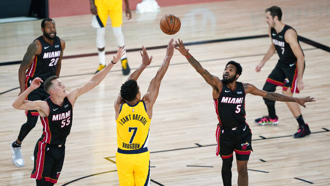 Indiana Pacers guard Malcolm Brogdon (7) shoots over Miami Heat forward Derrick Jones Jr. (5) during the second half of an NBA basketball first round playoff game, Tuesday, Aug. 18, 2020, in Lake Buena Vista, Fla. (AP Photo/Ashley Landis, Pool)