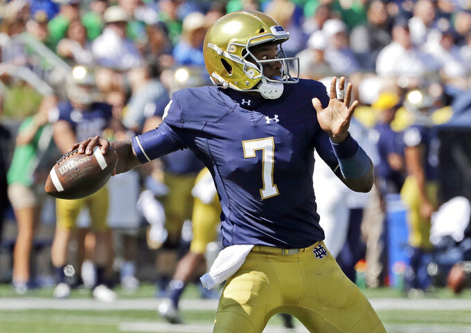 FILE - In this Sept. 15, 2018, file photo, Notre Dame quarterback Brandon Wimbush looks to throw against Vanderbilt during the first half of an NCAA college football game in South Bend, Ind. Two people familiar with the decision say No. 3 Notre Dame will start quarterback Brandon Wimbush against Florida State on Saturday for Ian Book, who is nursing an undisclosed injury. The people spoke Thursday, Nov. 8, 2018, to The Associated Press on condition of anonymity to because no official announcement was forthcoming. Notre Dame coach Brian Kelly had a scheduled news conference later Thursday.  (AP Photo/Nam Y. Huh, File)
