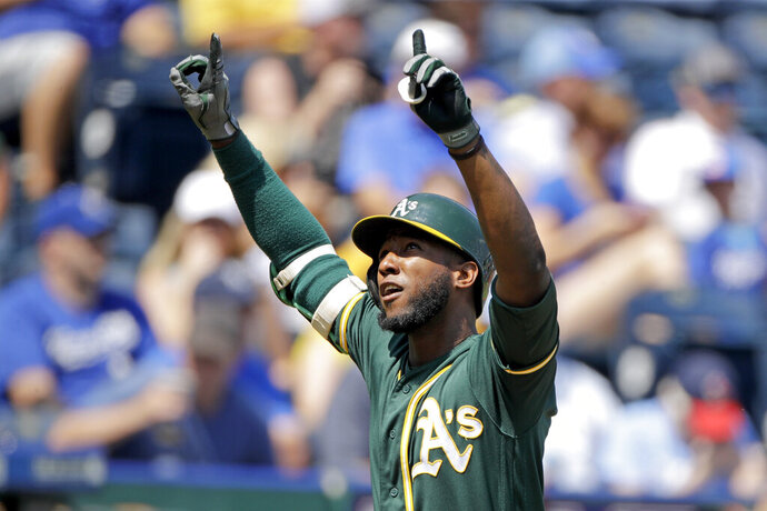 Oakland Athletics' Jurickson Profar celebrates as he crosses the plate after hitting a two-run home run during the fourth inning of a baseball game against the Kansas City Royals Thursday, Aug. 29, 2019, in Kansas City, Mo. (AP Photo/Charlie Riedel)