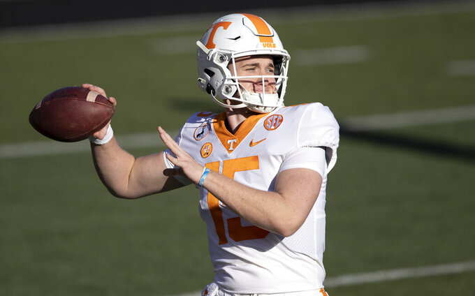 Tennessee quarterback Harrison Bailey (15) throws to a receiver during warmups of an NCAA college football game Saturday, Dec. 12, 2020, in Nashville, Tenn. (AP Photo/Wade Payne)