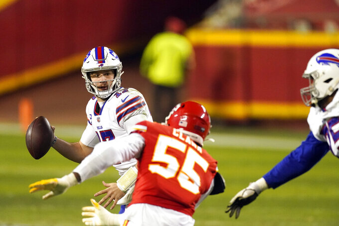 Buffalo Bills quarterback Josh Allen is pressured by Kansas City Chiefs defensive end Frank Clark (55) during the second half of the AFC championship NFL football game, Sunday, Jan. 24, 2021, in Kansas City, Mo. (AP Photo/Charlie Riedel)