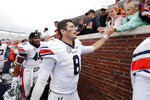 Auburn quarterback Jarrett Stidham (8) is congratulated by fans following his team's 31-16 win in the NCAA college football game against Mississippi, Saturday, Oct. 20, 2018, in Oxford, Miss. (AP Photo/Rogelio V. Solis)