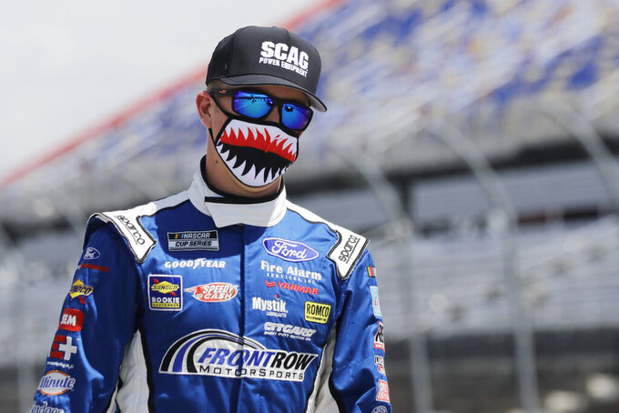 CORRECTS TO  JOHN HUNTER NEMECHEK INSTEAD OF MICHAEL MCDOWELL  - Driver John Hunter Nemechek walks to his car before the start of the NASCAR Cup Series auto race Sunday, May 17, 2020, in Darlington, S.C. (AP Photo/Brynn Anderson)