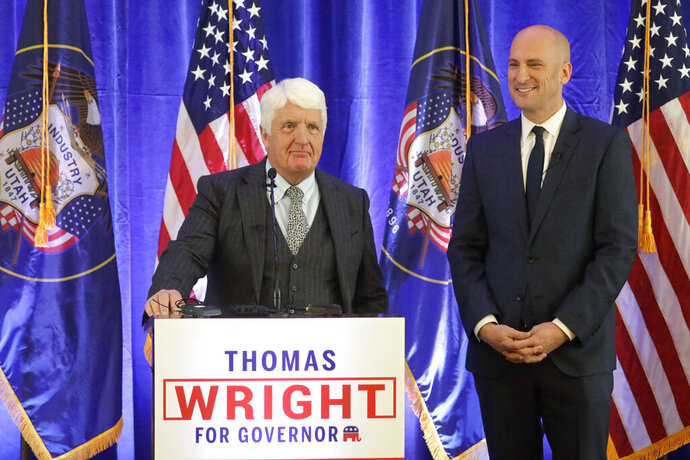 Utah governor candidate and ex-GOP chair Thomas Wright, right, looks on as Congressman Rob Bishop, left, speaks during a campaign announcement Thursday, Jan. 16, 2020, in Salt Lake City. Wright is adding a political heavyweight to his run for governor: Congressman Rob Bishop. Wright announced that Bishop will be his lieutenant-governor candidate. Bishop had already said he would not run for a ninth term in the U.S. House. (AP Photo/Rick Bowmer)