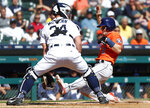 Houston Astros' Alex Bregman (2) scores at home plate as Detroit Tigers catcher James McCann (34) waits for the throw in the fifth inning of a baseball game in Detroit, Wednesday, Sept. 12, 2018. (AP Photo/Paul Sancya)