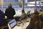 ADDS DATE - This Dec. 15, 2019, photo shows Baltimore Ravens Spanish-speaking broadcast team calling the game at M&T Bank Stadium, play-by-play announcer David Andrade, left, color commentator Gustavo Salazar, center, and producer Ximena Lugo-Latorre, right, can be heard on La Nueva 87.7 FM. (Kevin Richardson/The Baltimore Sun via AP)