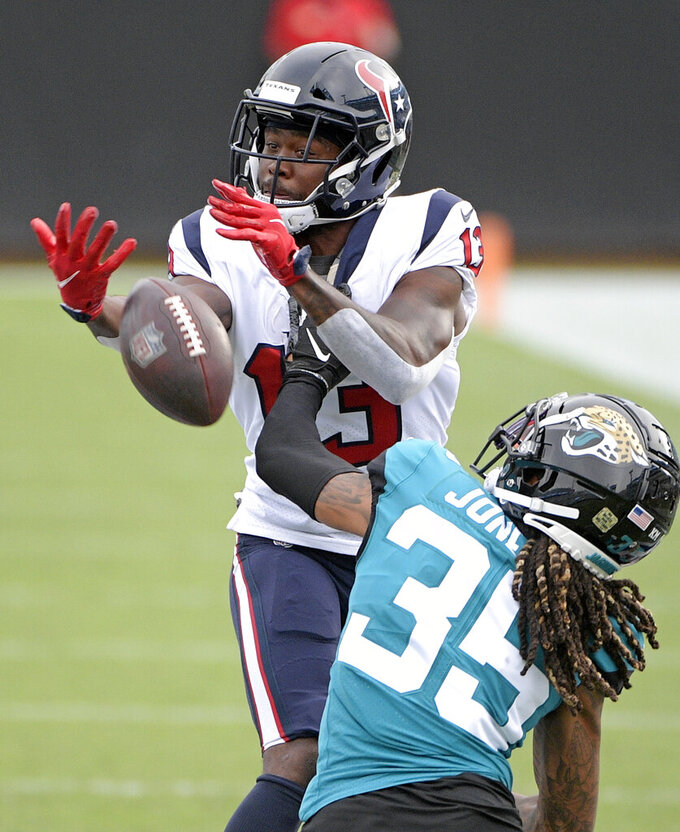 Jacksonville Jaguars cornerback Sidney Jones (35) breaks up a pass for Houston Texans wide receiver Brandin Cooks (13)during the second half of an NFL football game, Sunday, Nov. 8, 2020, in Jacksonville, Fla. (AP Photo/Phelan M. Ebenhack)