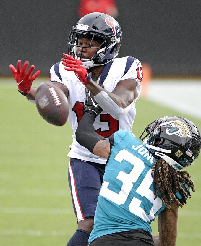 Jacksonville Jaguars cornerback Sidney Jones (35) breaks up a pass for Houston Texans wide receiver Brandin Cooks (13)during the second half of an NFL football game, Sunday, Nov. 8, 2020, in Jacksonville, Fla. (AP Photo/Phelan M. Ebenhack)