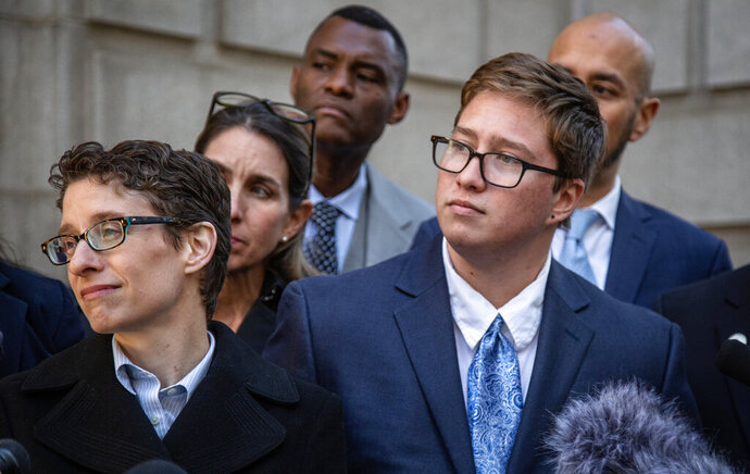 Transgender student Drew Adams, right, and his attorney, Tara Borelli, listen to questions from reporters outside of the 11th Circuit Court of Appeals on Thursday, Dec. 5, 2019, in Atlanta. Adam's fight over school bathrooms comes before a federal appeals court Thursday, setting the stage for a groundbreaking ruling. Adams, who has since graduated from Nease High School in Ponte Vedra, won a lower court ruling last year ordering the St. Johns County school district to allow him to use the boys' restroom. The district has since appealed. (AP Photo/ Ron Harris)