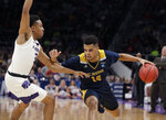 UC Irvine guard Evan Leonard (14) drives against Kansas State guard Kamau Stokes during the second half of a first round men's college basketball game in the NCAA Tournament Friday, March 22, 2019, in San Jose, Calif. (AP Photo/Chris Carlson)