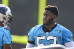 Carolina Panthers defensive end Brian Burns, right, talks to a teammate during practice at the NFL football team's training camp in Spartanburg, S.C., Thursday, July 29, 2021. (AP Photo/Nell Redmond)